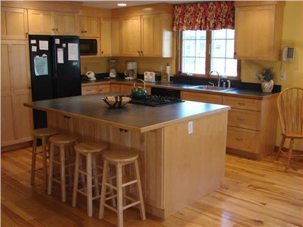 East Harwich Cape Cod vacation rental - Eat-in kitchen w/ modern appliances and breakfast bar