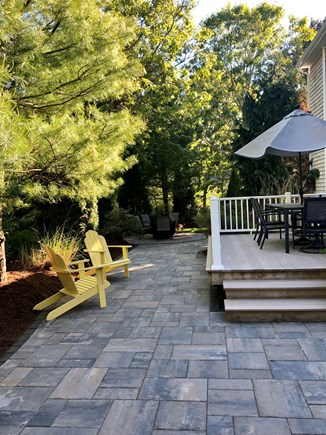 West Harwich Cape Cod vacation rental - Large backyard patio & fire table w/ample space to entertain