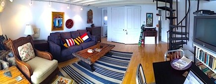 Provincetown, Next to Macmillan Wharf / BEST Cape Cod vacation rental - Living Room, with indoor dining area and stairs up to the bedroom