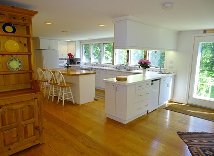 near Skaket beach in Orleans Cape Cod vacation rental - Large, sun-filled kitchen overlooking acre+ backyard