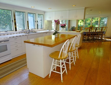 near Skaket beach in Orleans Cape Cod vacation rental - Kitchen with breakfast bar seating, opens to dining area