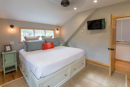 North Eastham Cape Cod vacation rental - Master Bedroom with king bed - swivel wall mount Smart HDTV