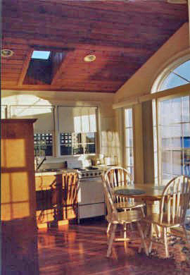 Lewis Bay, West Yarmouth Cape Cod vacation rental - Sunrise in the kitchen w/ skylite & wood ceiling