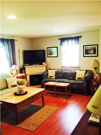 East Falmouth Cape Cod vacation rental - Sunny living room into kitchen with breakfast bar