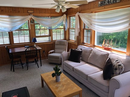 West Hyannisport Cape Cod vacation rental - Love this sunporch for relaxing and the sofa is a pull out bed.