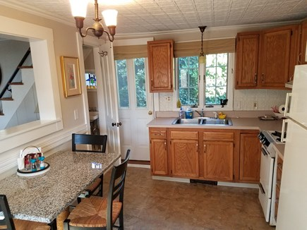 Provincetown Cape Cod vacation rental - Kitchen, door leads to second patio and grill