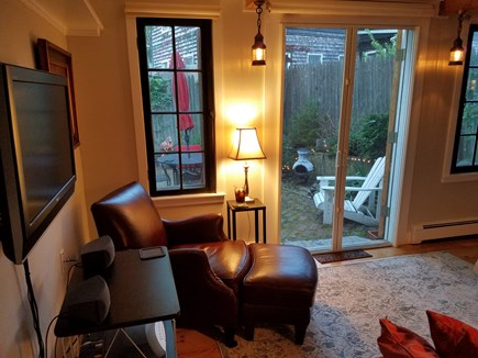 Provincetown Cape Cod vacation rental - Living room opens into backyard through large double doors