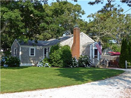 Harwich Port Cape Cod vacation rental - Clam shell driveway, side view of home with patio