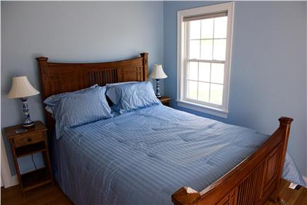 Harwich Cape Cod vacation rental - Master bedroom features a queen-sized bed with slider to deck.
