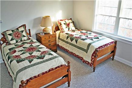 Harwich Cape Cod vacation rental - Extra-long twin beds overlook woods and pond from second floor.