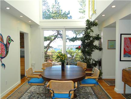 Wellfleet 4 acres on the inner Cape Cod vacation rental - Vaulted dining room with slider to deck, harbor views