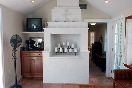 East Falmouth in the historic  Cape Cod vacation rental - Raised indoor fireplace in large open kitchen