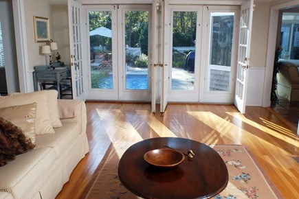East Falmouth in the historic  Cape Cod vacation rental - Living Room looking out to pool