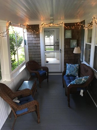 Harwich Port Cape Cod vacation rental - Relaxing Screen porch off of Kitchen