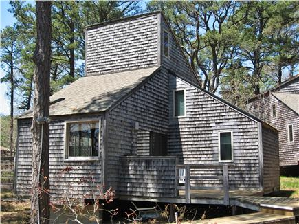 South Wellfleet Cape Cod vacation rental - Rental ID 7417 showing front deck and the 3 cathedral ceilings