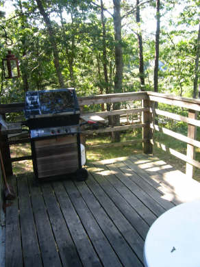 South Wellfleet Cape Cod vacation rental - View from the back deck to pond without table and chairs set up