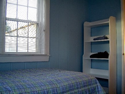 Wellfleet Cape Cod vacation rental - Shelves in 2nd bedroom.  Dresser is at foot of other bed, too.