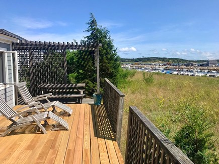 Wellfleet Cape Cod vacation rental - Teak chaisse lounges (w cushions) & picnic table facing Harbor.