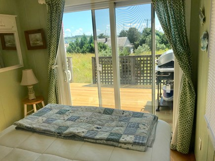 Wellfleet Cape Cod vacation rental - View from 1st bedroom (queen) thru glass sliders to deck & water.