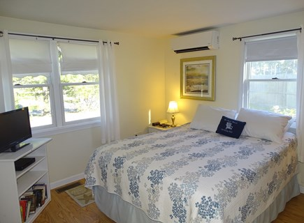 South Yarmouth Cape Cod vacation rental - Master bedroom with queen bed on first floor with AC