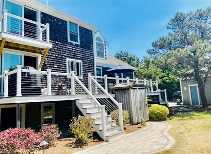 Eastham Cape Cod vacation rental - Back view of the house, outdoor shower and private yard.