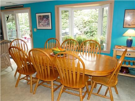 Orleans, Mayflower Point Cape Cod vacation rental - Large dining room table with bay window facing back yard