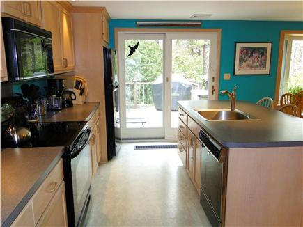 Mayflower Point, Orleans, MA Cape Cod vacation rental - Updated kitchen with breakfast bar, slider to deck