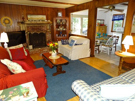 Eastham Cape Cod vacation rental - Living room with TV, 3 couches, fireplace, opens to kitchen