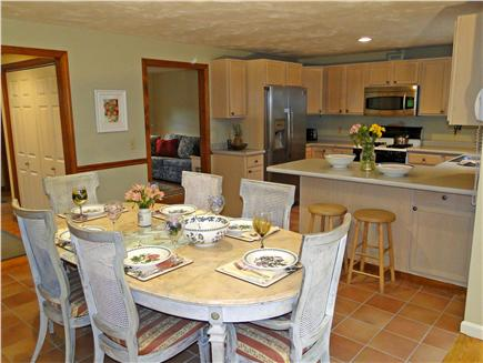 Harwichport  Cape Cod vacation rental - Spacious dining room , u shaped kitchen, extra chairs/leaves