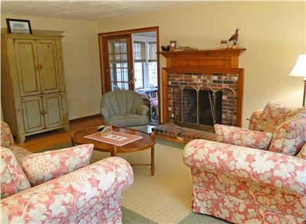 S.Harwich/S.Chatham border Cape Cod vacation rental - Bright living room with fireplace, two sofas,chair