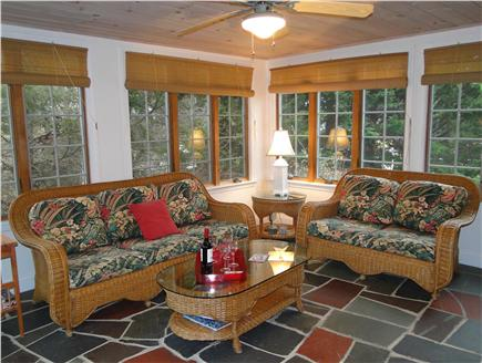 Harwichport Cape Cod vacation rental - Relaxing sunroom/ porch off living room seats 6