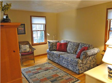 Harwichport Cape Cod vacation rental - Bonus room off kitchen  with TV  arnoire & sofa bed