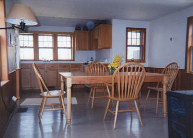 Brewster Cape Cod vacation rental - Open kitchen and dining area with gas fireplace/stove