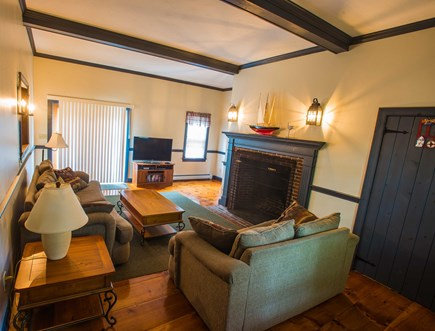 West Yarmouth Cape Cod vacation rental - Main living room with high beamed ceiling and oversized fireplace