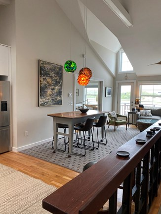 Provincetown Cape Cod vacation rental - View from top of stairs to dining area and living room