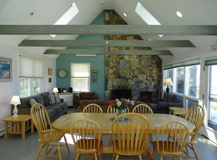 East Dennis Cape Cod vacation rental - Dining room and living room with wall of windows facing water