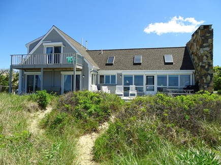 East Dennis Cape Cod vacation rental - View of house from the top of the stairs that lead to beach