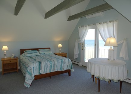 East Dennis Cape Cod vacation rental - Upstairs queen bedroom with sitting area and private deck