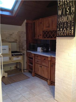 Dennis Port Cape Cod vacation rental - Kitchen with restored antique stove and ceramic tile floors