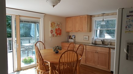 Chatham Cape Cod vacation rental - Sunny granite kitchen with maple cabinets. Slider to deck