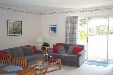 Brewster - Ocean Edge Resort Cape Cod vacation rental - Living Room with slider to private patio