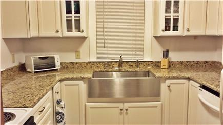 West Yarmouth Cape Cod vacation rental - Newly renovated kitchen with granite counters and farmer's sink.