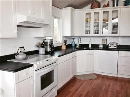 North Eastham Cape Cod vacation rental - Upstairs Kitchen with breakfast nook and dining room