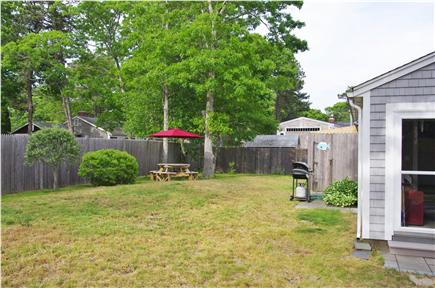 South Yarmouth Cape Cod vacation rental - Spacious enclosed back yard w/outdoor shower great for cookouts