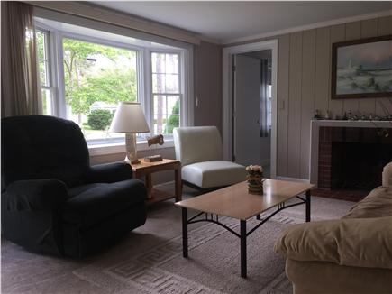 South Yarmouth Cape Cod vacation rental - Spacious living room with fireplace