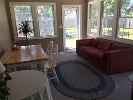 South Yarmouth Cape Cod vacation rental - Step out from the kitchen to a fully enclosed picturesque sunroom