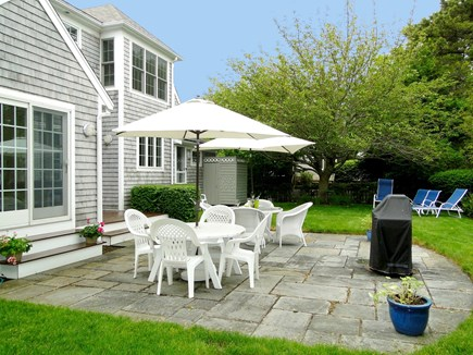 New Seabury/(Popponesset) New Seabury vacation rental - Back yard with patio, grill, lawn and outdoor shower