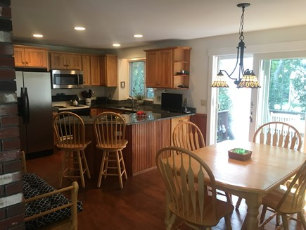 Near Harwich center/park/bike  Cape Cod vacation rental - Kitchen & Dining Area with slider to the private deck & spa