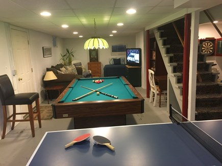Near Harwich center/park/bike  Cape Cod vacation rental - Lower level game room with pool table, ping pong, TV and games.