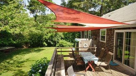 Brewster Cape Cod vacation rental - Backyard, living, cooking eating area.